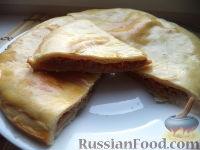 Фото к рецепту: Пирог с квашеной капустой