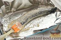 Фото приготовления рецепта: Щука, запеченная целиком (в фольге) - шаг №6
