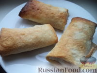 Фото к рецепту: Лаваш с тыквой, запеченный в духовке