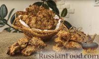 Фото к рецепту: Овсяное печенье с изюмом и орехами