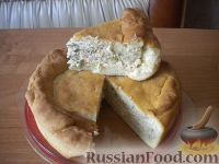 Фото к рецепту: Пирог с рыбой и рисом