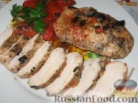 Фото к рецепту: Куриные грудки с тушеными помидорами