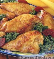 Фото к рецепту: Маринованная куриная грудка, запеченная в духовке