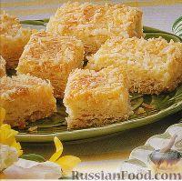 Фото к рецепту: Кокосовый пирог со сгущенкой, из слоеного теста