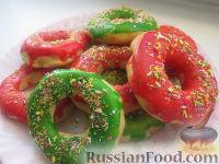 Фото к рецепту: Вкусные пончики с глазурью (в духовке)