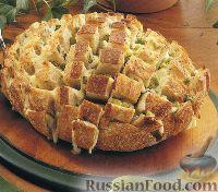 Фото к рецепту: Закусочный хлеб с сыром и луком