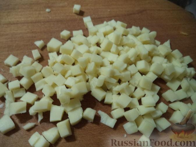 Фото приготовления рецепта: Запеканка из свиного фарша с кабачками, рисом и брусникой - шаг №5