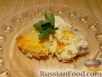 Фото к рецепту: Судак с картофелем под сырным соусом