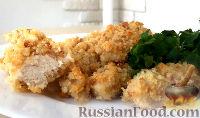 Фото к рецепту: Куриная грудка, запеченная в сухарях