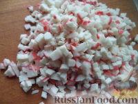 Фото приготовления рецепта: Яйца, фаршированные крабовыми палочками - шаг №5