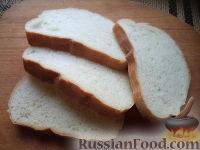 Фото приготовления рецепта: Бутерброды с печенью трески и яйцами - шаг №6