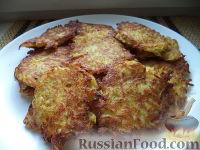 Фото к рецепту: Драники с сыром и чесноком
