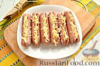 Фото приготовления рецепта: Сосиски, запеченные с сыром - шаг №6