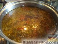 Фото приготовления рецепта: Щи из квашеной капусты - шаг №11