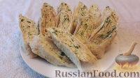 Фото к рецепту: Рулет из лаваша, с яйцами и плавленым сыром