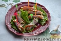 Фото к рецепту: Рулетики из ветчины с сыром и соленым огурцом