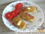 Фото к рецепту: Картофельные зразы из сырой картошки с мясом
