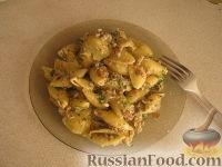 Фото к рецепту: Паста с грибами и руколой