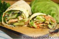 Фото к рецепту: Роллы (рулет) из лаваша, с рыбой, капустой, огурцом и морковью