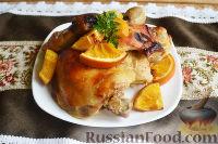 Фото к рецепту: Курица, запеченная с апельсинами