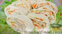 Фото к рецепту: Рулет из лаваша с крабовыми палочками и морковью