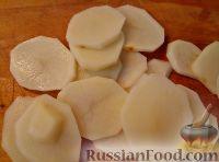 Фото приготовления рецепта: Треска, запеченная с картофелем и овощами - шаг №6