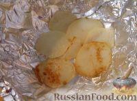 Фото приготовления рецепта: Треска, запеченная с картофелем и овощами - шаг №9