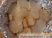Фото приготовления рецепта: Треска, запеченная с картофелем и овощами - шаг №12