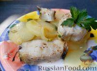 Фото к рецепту: Минтай, тушенный с картофелем