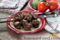 Фото к рецепту: Шашлык из свинины в виде рулетиков