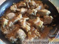 Фото к рецепту: Тушеная свинина в собственном соку