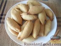 Фото к рецепту: Пирожки с отварной курицей