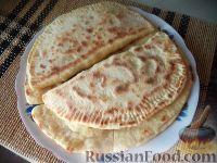 Фото к рецепту: Лепешки с зеленью и сыром (по-кавказски)