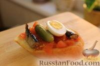Фото к рецепту: Бутерброды со шпротами и яйцом