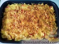 Фото к рецепту: Картофель с ветчиной и помидорами, под сырной корочкой