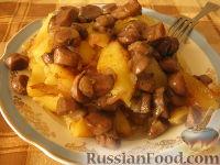 Фото к рецепту: Картофель жареный с грибами