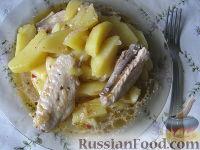 Фото к рецепту: Жаркое из куриных крылышек с картофелем