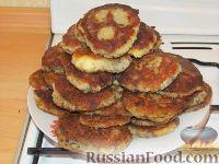 Фото к рецепту: Картофельные оладьи с грибами и луком