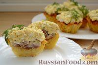 Фото к рецепту: Картофельные корзинки с селедкой