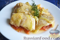 Фото к рецепту: Рыба, запеченная с кабачками и помидорами