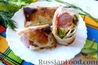 Фото к рецепту: Сосиски в лаваше, с маринованными огурцами и сыром