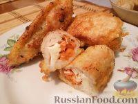 Фото к рецепту: Куриные рулетики с корейской морковью и сыром