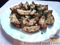 Фото к рецепту: Запеченный картофель с чесноком