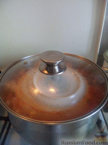 Фото приготовления рецепта: Перец, фаршированный рисом и баклажанами - шаг №13