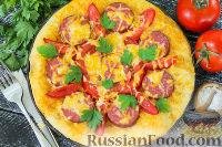 Фото к рецепту: Пицца с колбасой, помидорами и сыром