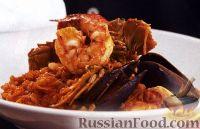 Фото к рецепту: Рис с морепродуктами по-португальски