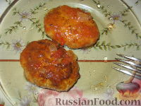 Фото к рецепту: Котлеты рыбные в томатном соусе