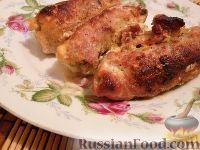 Фото к рецепту: Мясные рулетики с грибами, сыром и яйцом