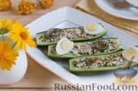Фото к рецепту: Закуска из огурцов с тунцом и анчоусами