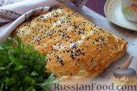 Фото к рецепту: Картофельно-мясной пирог из слоеного теста